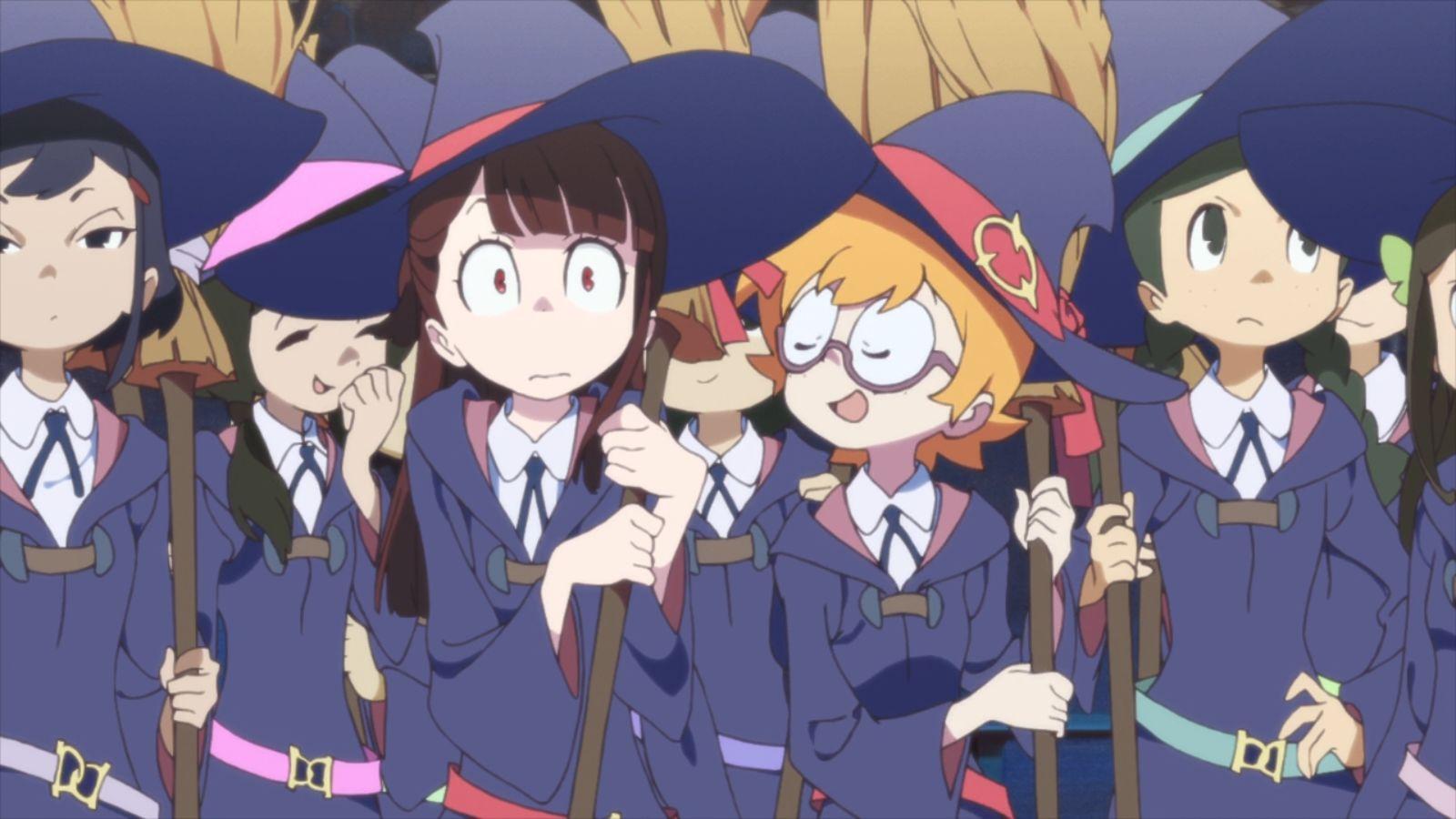 Akko e la sua amica Lotte si preparano a decollare con le scope.