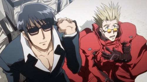 Nicholas D. Wolfwood wearing sunglasses, Vash the Stampede with hand on chest, Trigun: Badlands Rumble