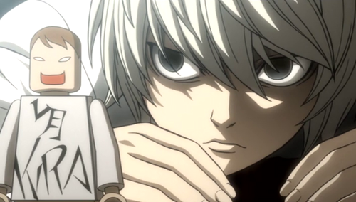 Near staring intently at one of his many toys, a Kira figure, used to solve puzzles